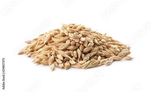 Raw barley on white background. Healthy grains and cereals