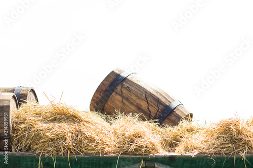 Carta da parati soft focus wooden barrels exterior decoration elements on cart with hay in summe