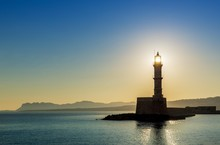 Chania Lighthouse With The Sun...