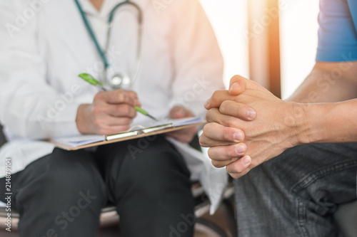 Fototapety, obrazy: Male patient having consultation with doctor or psychiatrist who working on diagnostic examination on men's health disease or mental illness in medical clinic or hospital mental health service center