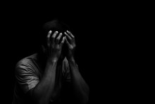 Man Sitting Alone Felling Sad Worry Or Fear And Hands Up On Head On Black Background