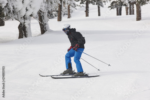 Fotobehang Wintersporten Man starting to learn how to ski. Winter sport