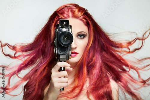 Beautiful Young Woman Using A Retro Video Camera Dyed Hair Girl