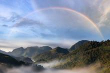 Mountain And Mist With Rainbow.