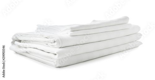 Fotografía  Stack of clean bed sheets on white background