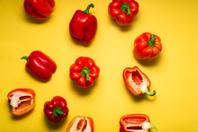 Fresh Red Bell Peppers On Bright Yellow Background, Top View