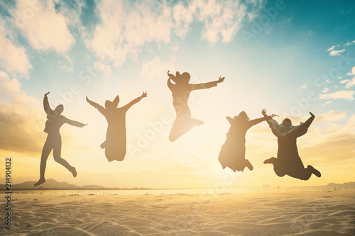 Happy family people group celebrate jump for good life on weekend concept for win victory, person faith in financial freedom healthy wellness, Great insurance team support retreat together in summer Fototapete
