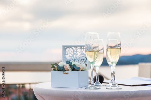 Wineglasses Of Ice Champagne On Table For Wedding Reception After