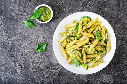 Tela Penne pasta with  pesto sauce, zucchini, green peas and basil
