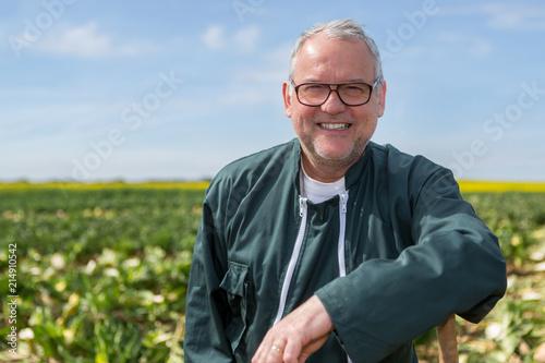 Fotografie, Obraz Portrait of a senior attractive farmer working in a field - Nature concept