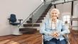 canvas print picture - Seniorin im Rollstuhl vor Treppenlift zu Hause