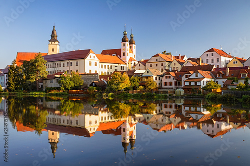 View of Telc across pond with reflections, southern Moravia, Czech Republic Canvas Print
