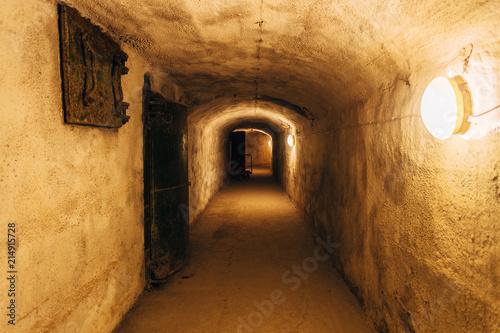 Photo  Dark corridor of old underground Soviet military bunker under fortification