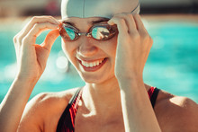 Confident Female Swimmer Near ...