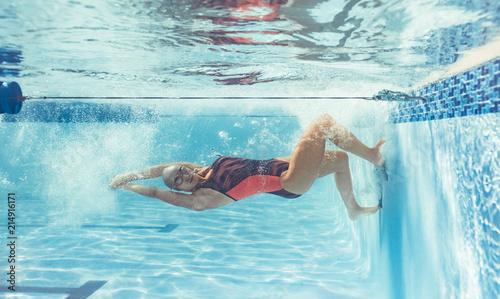Woman under water in swimming pool