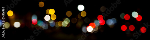 Obraz Bokeh traffic light at night in the street of a big city - fototapety do salonu