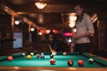 Couple Playing Snookers In Club