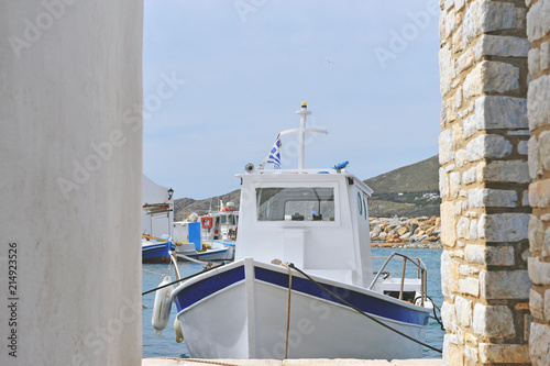 Traditional fisher boat with national flag of Greece