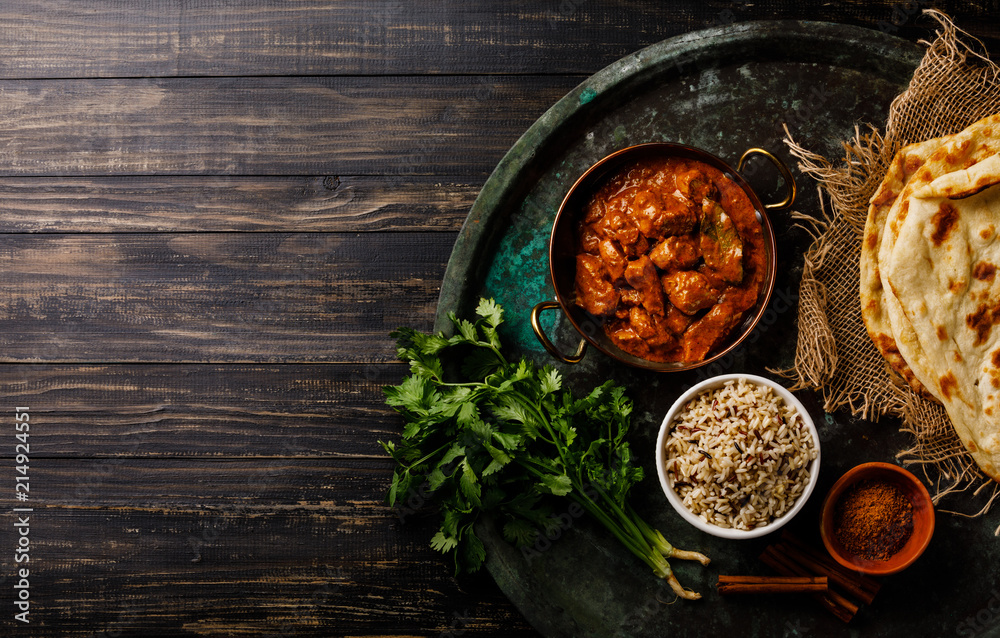 Fototapety, obrazy: Chicken tikka masala spicy curry meat food with rice and naan bread on dark background copy space