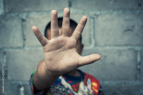 Obraz na plátne Stop, Child standing with outstretched hand showing stop, Violence concept