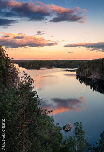 Garden Poster Pale violet Scenic high angle view with sunrise and peaceful lake at summer evening in Finland