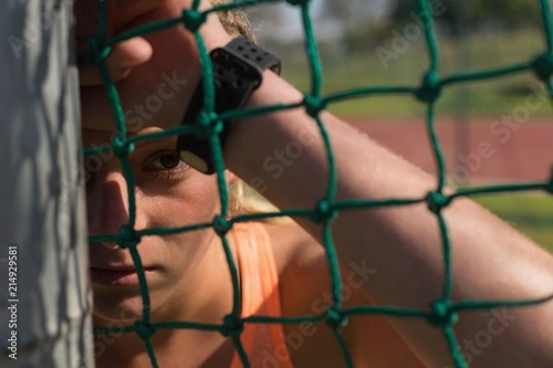 Female athlete relaxing at sports venue