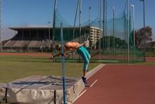 Female Athlete Practicing High Jump
