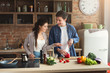 canvas print picture - Happy couple cooking dinner together