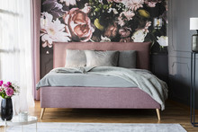 Grey Sheets On Pink Bed In Feminine Bedroom Interior With Flowerss Print On The Wall. Real Photo