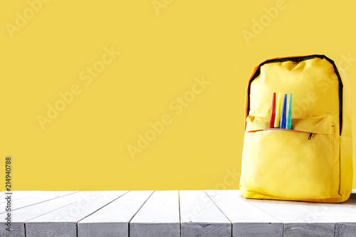 Obraz Yellow school backpack and free space for your decoration.  - fototapety do salonu