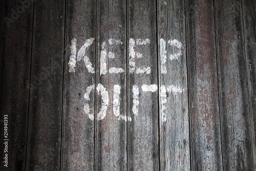 Keep Out. Keep out sign on a weathered wooden background. Canvas Print