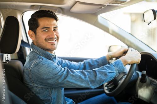 Obraz Attractive man driving a car - fototapety do salonu
