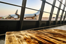 Wooden Desk Of Free Space And Airport Background With Big Window
