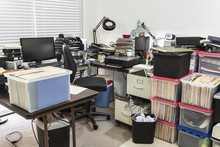 Messy Business Office With Clu...