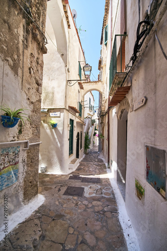 a narrow street in the summer resort city