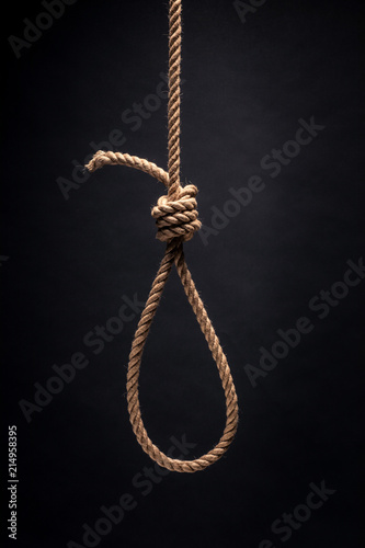 Photo Noose. The concept of murder or suicide. On dark background