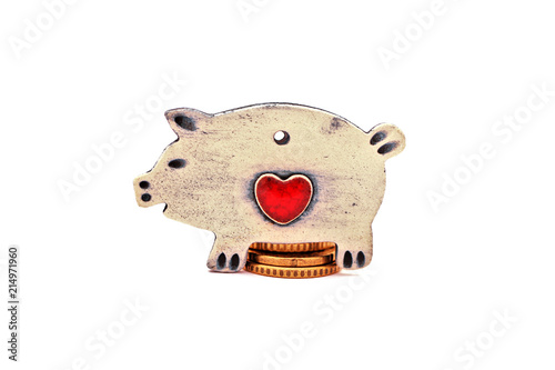 Fotografie, Obraz  Ceramic piggy is sitting on coins. Isolated on white background.