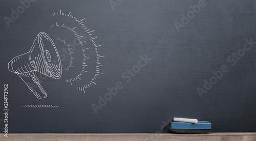Fotografía  megaphone on the blackboard with chalk