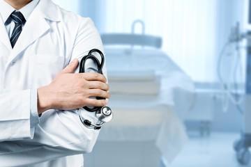 Man doctor holding stethoscope