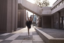 Woman Performing Ballet In The City