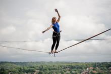 Young Woman Balancing Tilted H...