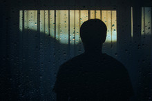 Lonely Man Stands In Front Of The Curtain With Artistic Raindrops Background.