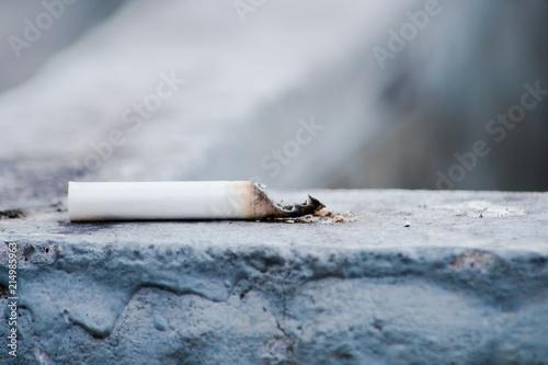 Fényképezés  The butt of the cigarette on a stone surface