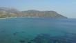 drone flight over the sea and beach of karpathos, greece.