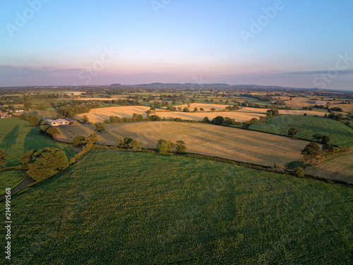 Foto Aerial view on cheshire plains and fields. Summer pink sunset