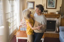Romantic Senior Couple Dancing...