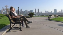 Couple Relaxing On San Diego C...