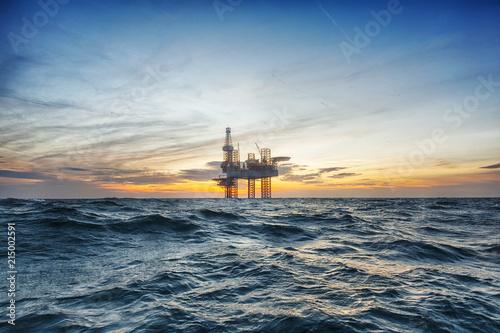Fototapeta Offshore drilling rig at sunset obraz