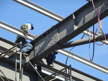 Metal Roof Trusses Installed By Construction Workers. The Metal Trusses Used To Support Metal Roof Sheet.