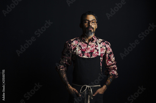 Portrait Of A Stylish Cook With Tattoos With Hands On Waist
